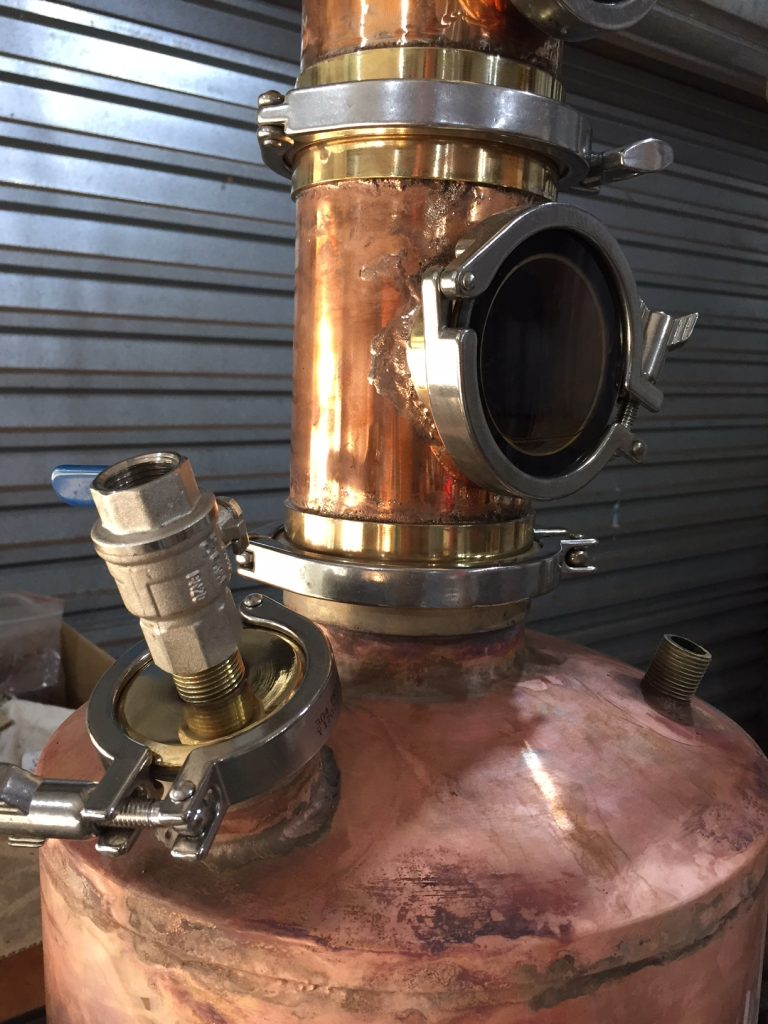 copper still boiler, pot still boiler, distillation boiler, gin basket, pot still neck, pot still, copper pot still, moonshine still, gin basket, copper gin basket, sight glass, brass tri-clamp ferrule, still column, copper still, gin distillation, copper bend, copper elbow, distillation column, bubble tee